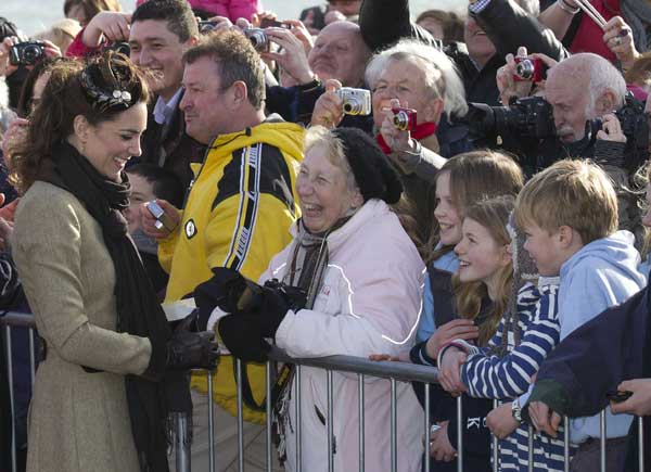 Kate Middleton, the future wife of Prince William greets wellwishers as they visit Trearddur Bay Lifeboat Station on the island of Anglesey, Wales, Thursday, Feb. 24, 2011. After their April 29 wedding the couple will live in North Wales where William has been since he embarked on a three-year posting as a Search and Rescue helicopter pilot at RAF Valley on Anglesey. <span class=meta>( &#40;AP Photo&#47;Jon Super&#41;.)</span>